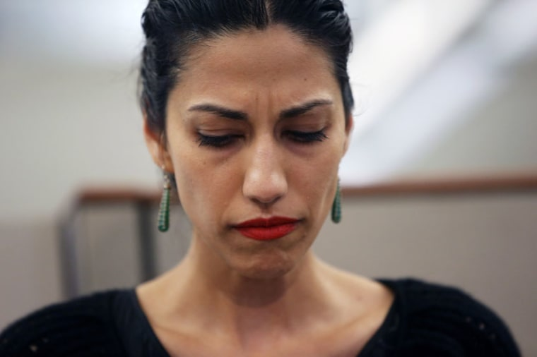 Huma Abedin, wife of Anthony Weiner, a leading candidate for New York City mayor, listens as her husband speaks at a press conference on July 23, 2013 in New York City. (Photo by John Moore/Getty Images)