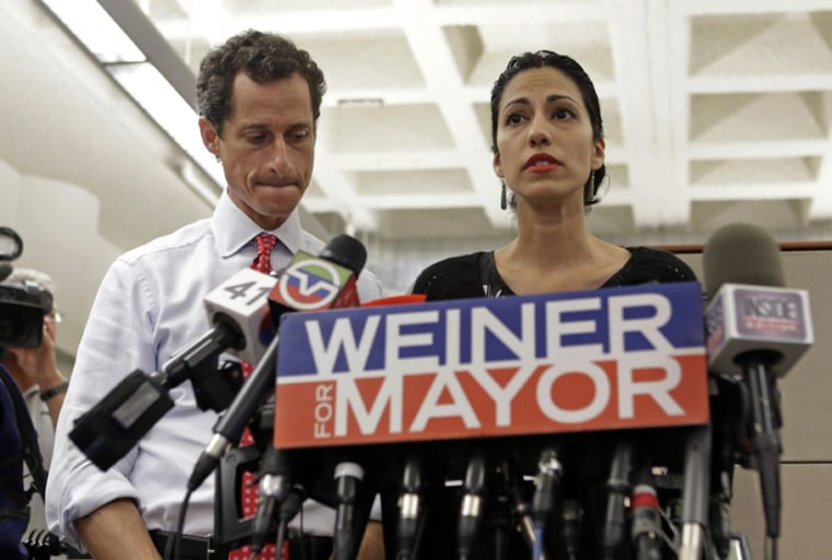 New York mayoral candidate Anthony Weiner, left, listens as his wife, Huma Abedin, speaks during a news conference at the Gay Men's Health Crisis headquarters, Tuesday, July 23, 2013, in New York.  (Photo by Kathy Willens/AP)