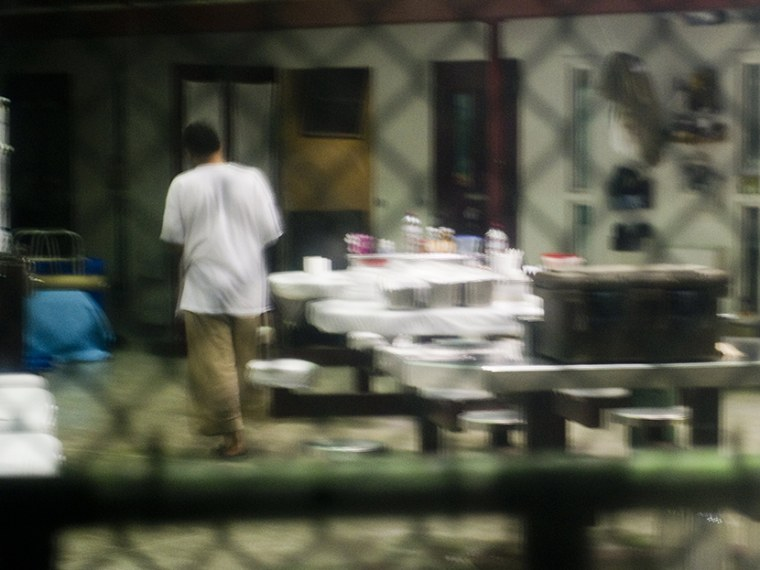 "This image reviewed by the US military shot through a one way mirror shows a detainee in Cell Block B of the ""Camp Six"" detention facility of the Joint Detention Group at the US Naval Station in Guantanamo Bay, Cuba, January 19, 2012.  (Photo by Jim..."