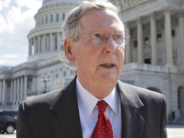 Senate Minority Leader Mitch McConnell, R-Ky., walks outside the U.S. Capitol in Washington, Tuesday, July 23, 2013, (Photo by J. Scott Applewhite/AP)