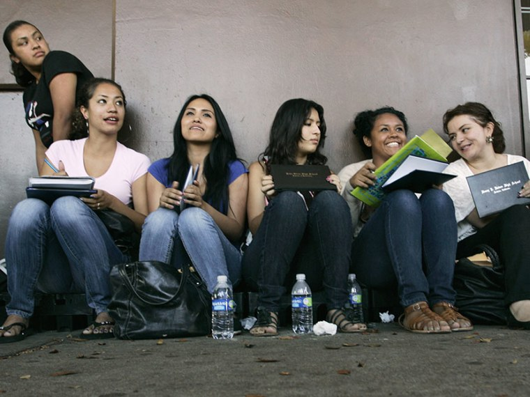 Students wait in line for assistance with paperwork for the Deferred Action for Childhood Arrivals program at the Coalition for Humane Immigrant Rights of Los Angeles in Los Angeles, California, August 15, 2012. (Photo by Jonathan Alcorn/Reuters)