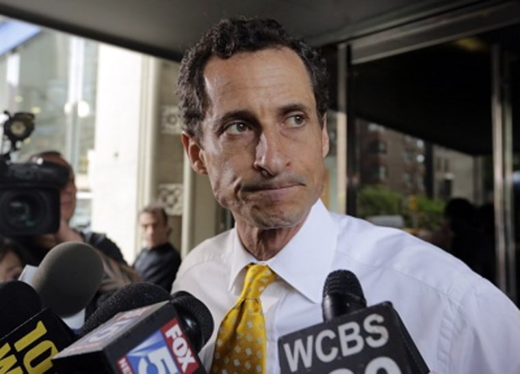 New York City mayoral candidate Anthony Weiner leaves his apartment building in New York on Wednesday, July 24, 2013. (Photo by Richard Drew/AP)