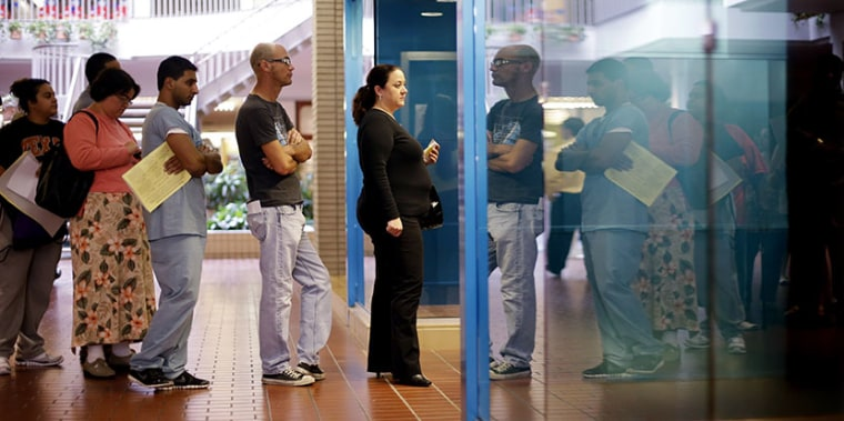 Voters wait in line at a polling place located inside a shopping mall, on Election Day, Tuesday, Nov. 6, 2012, in Austin, Texas. (Photo by Eric Gay/AP)