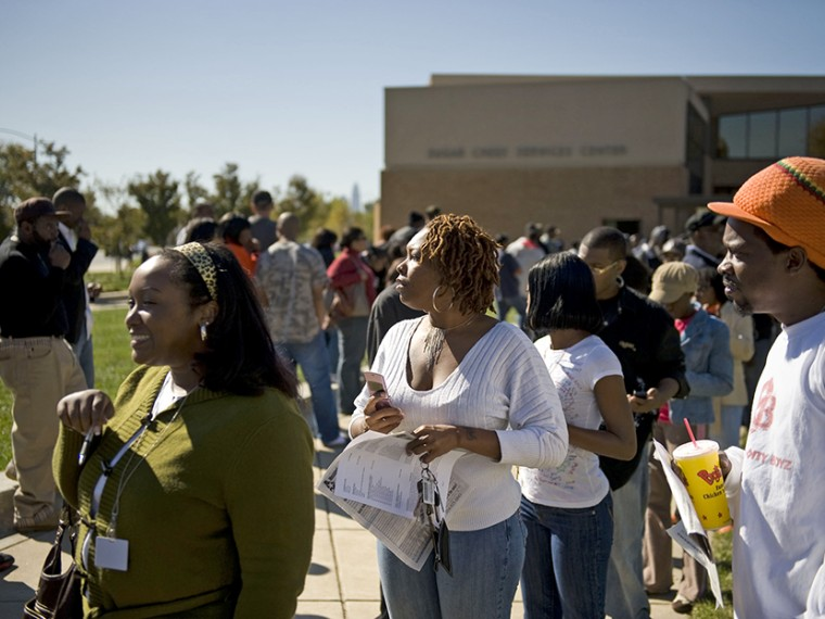 Early voters line up outside of the Sugar Creek branch library on North Tryon Street on October 31, 2008 in Charlotte, North Carolina.  (Photo by Davis Turner/Getty Images)