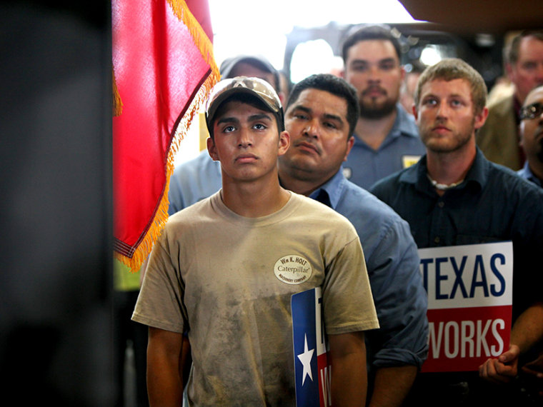 Employees of Holt Cat listen as Texas governor Rick Perry announces he is not running for re-election as governor of Texas in 2014 during a news conference in San Antonio, Texas July 8, 2013.   (Photo by Erich Schlegel/Reuters)