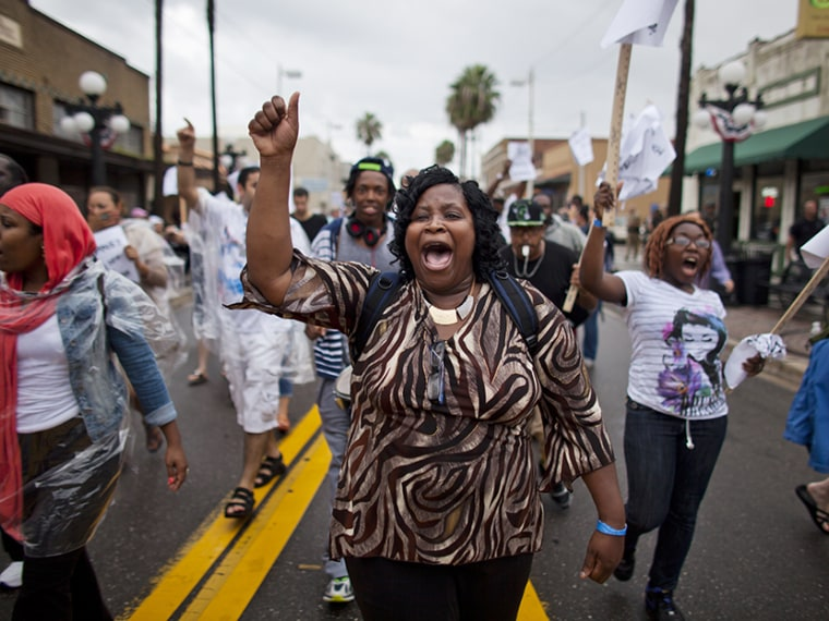Protestors against voter suppression march on what was supposed to be the opening day of the Republican National Convention in Ybor City, Florida, on August 27, 2012. (Photo by Jim Lo Scalzo/EPA)