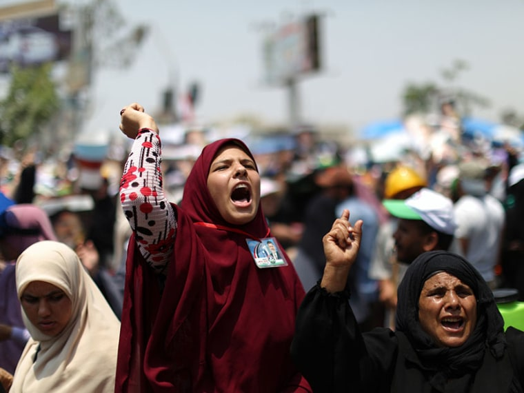 Supporters of deposed Egyptian president Mohamed Morsi shout slogans during a rally in support of the former Islamist leader outside Cairo's Rabaa al-Adawiya mosque on July 9, 2013.  (Photo by Mahmud Hamsmahmud Hams/AFP/Getty Images)