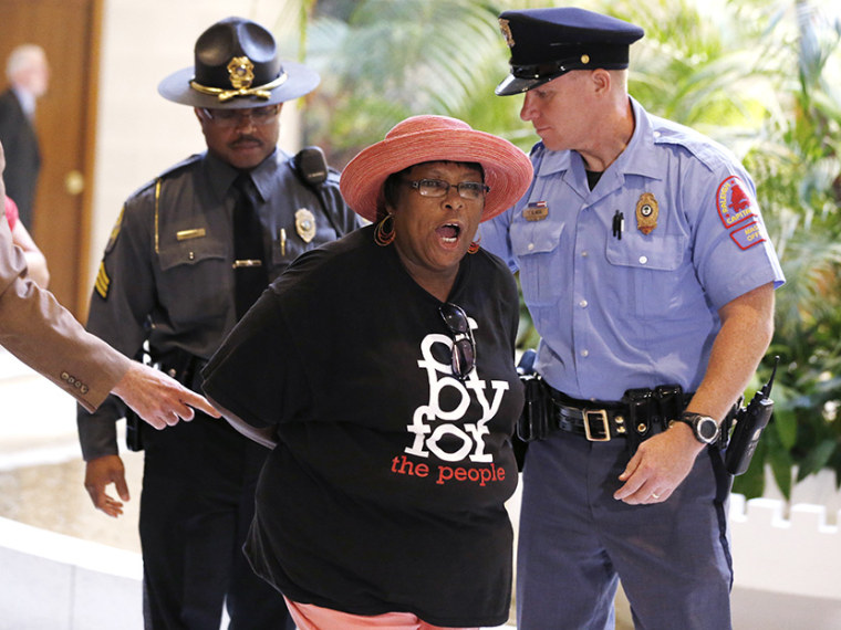 "Demonstrators are arrested during ""Moral Monday"" demonstrations at the North Carolina Legislative Building in Raleigh, N.C., Monday, July 22, 2013. (Photo by Ethan Hyman/The News & Observer/AP)"