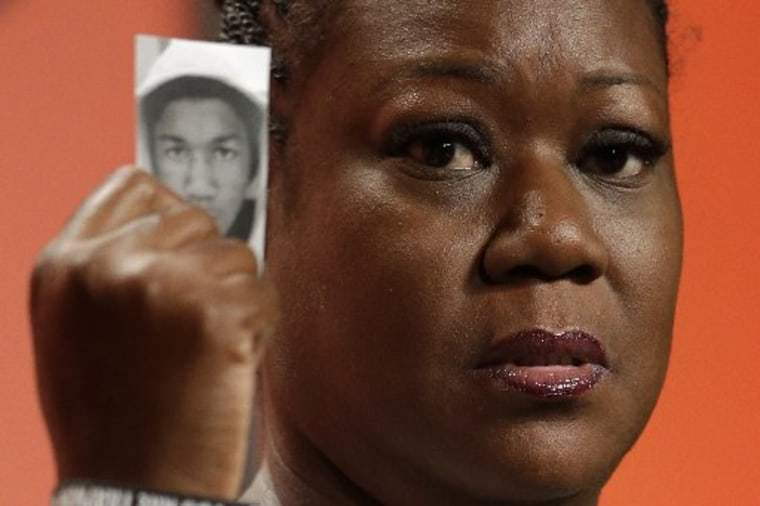 Sybrina Fulton, mother of Trayvon Martin, holds up a card with a photo of her son as she speaks at the National Urban League's annual conference, Friday, July 26, 2013, in Philadelphia. Fulton told the National Urban League gathering to use her story,...