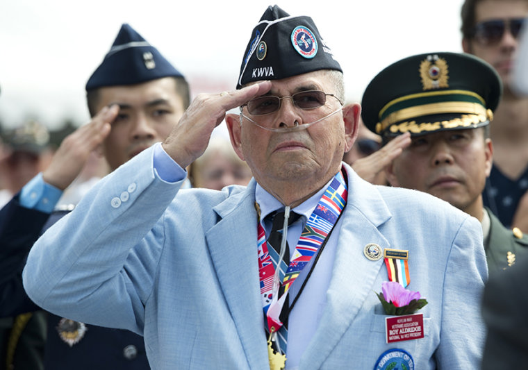 Roy Aldridge of the Korean War Veterans Association salutes during a ceremony to commemorate the 60th anniversary of the signing of the Armistice that ended the Korean War, at the Korean War Veterans Memorial in Washington, DC, July 27, 2013. (Photo by...