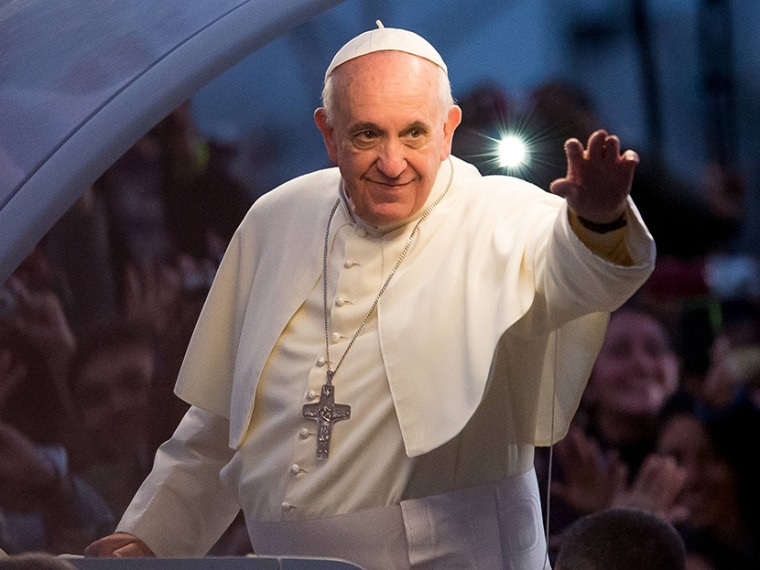Pope Francis waves from the Popemobile on his way to attend the Via Crucis on Copacabana Beach during World Youth Day celebrations on July 26, 2013 in Rio de Janeiro, Brazil. (Photo by Buda Mendes/Getty Images)
