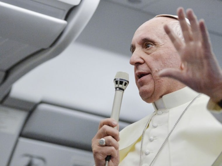 Pope Francis talks with journalists as he flies back Rome following his visit to Brazil July 29, 2013. (Photo by Luca Zennaro/Pool/Reuters)