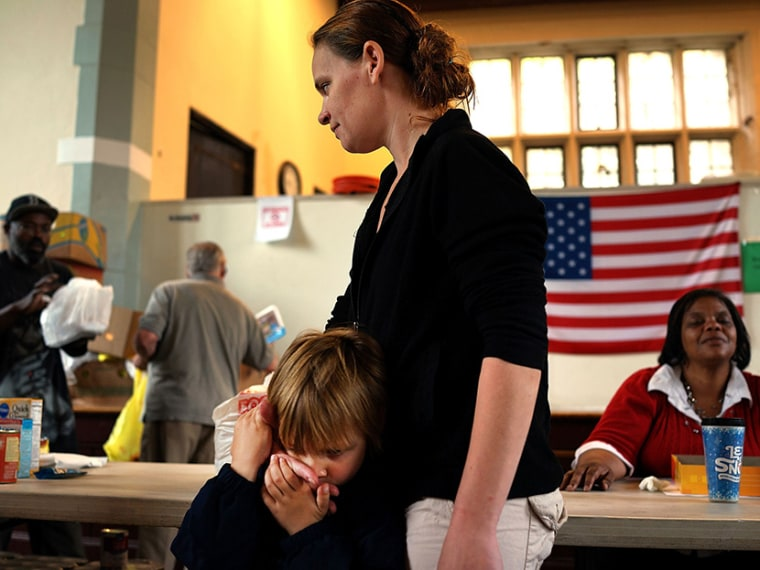 Mlissa Ruella and her son Randy, 3,  wait in line for groceries at the Greater Waterbury Interfaith Ministries on May 20, 2013 in Waterbury, Connecticut. Waterbury, once a thriving industrial city with one of the largest brass manufacturing bases in...