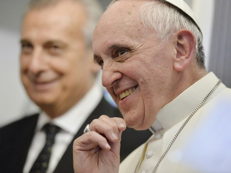 Pope Francis listens to journalists' questions as he flies back Rome following his visit to Brazil July 29, 2013.(Photo by Luca Zennaro/Reuters)