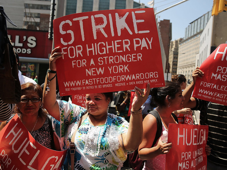 Employees and supporters demonstrate outside of a Wendy's fast-food restaurant to demand higher pay and the right to form a union on July 29, 2013 in New York City. (Photo by Spencer Platt/Getty Images)