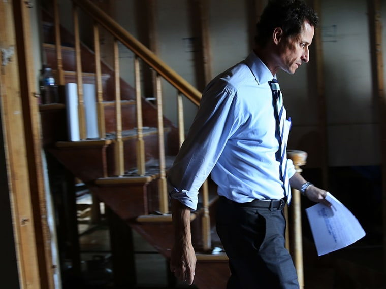Anthony Weiner, a leading candidate for New York City mayor, walks out of a storm damaged home after meeting with residents in Staten Island whose homes were damaged by Hurricane Sandy on July 26, 2013 in New York City. (Photo by Spencer Platt/Getty...