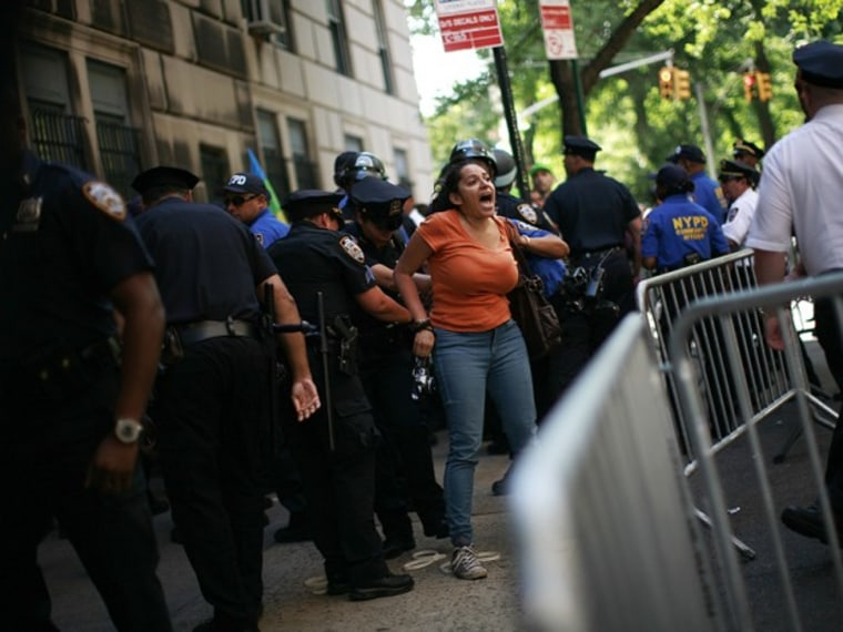 """A woman is taken into custody by police following a protest in New York June 17, 2012. Thousands of New Yorkers marched in silence down Fifth Avenue on Sunday to demand an end to the New York Police Department's """"stop-and-frisk"""" program, which the..."""