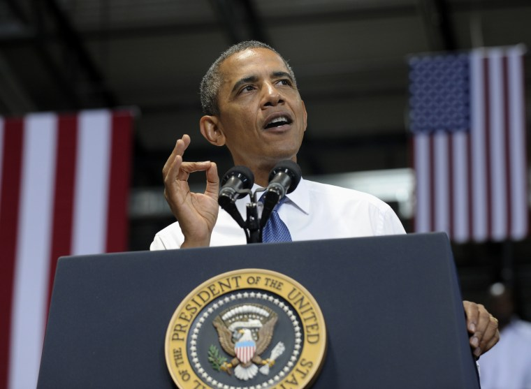 President Barack Obama gestures as he speaks at the Amazon fulfillment center in Chattanooga, Tenn., Tuesday, July 30, 2013. Obama came to Chattanooga to give the first in a series of policy speeches on his proposals for private sector job growth and...