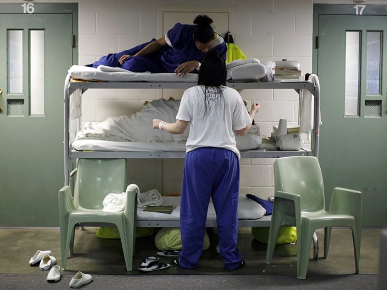 Women chat as they lie in beds placed in the communal area outside cells, due to overcrowding at the Los Angeles County Women's jail in Lynwood, California April 26, 2013. (Photo by Lucy Nicholson/Reuters)