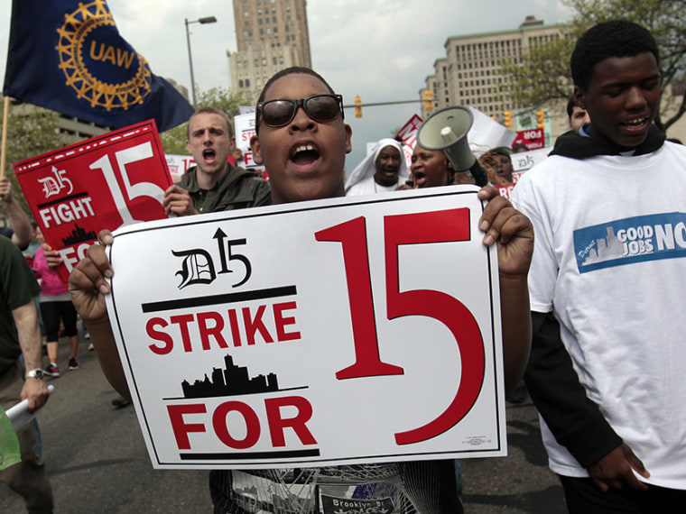 A group of workers and labor activists march down West Grand Boulevard as they demand a raise in the minimum wage for fast food workers in Detroit, Michigan May 10, 2013.  (Photo by Rebecca Cook/Reuters)