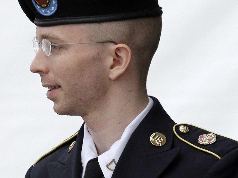Army Pfc. Bradley Manning is escorted out of a courthouse in Fort Meade, Md., Tuesday, July 30, 2013, after receiving a verdict in his court martial. (Photo by Patrick Semansky/AP)