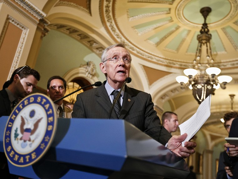 Senate Majority Leader Harry Reid of Nev. gestures as he speaks with reporters, on  Capitol Hill in Washington, Tuesday, July 30, 2013, after a Democratic strategy session. (Photo by J. Scott Applewhite/AP)