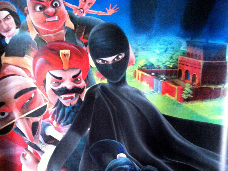 """This Thursday, July 11, 2013 photo shows a poster for the \""""Burka Avenger\"""" cartoon series, which is scheduled to start running on Geo TV in early August. (AP Photo/Sebastian Abbot)"""