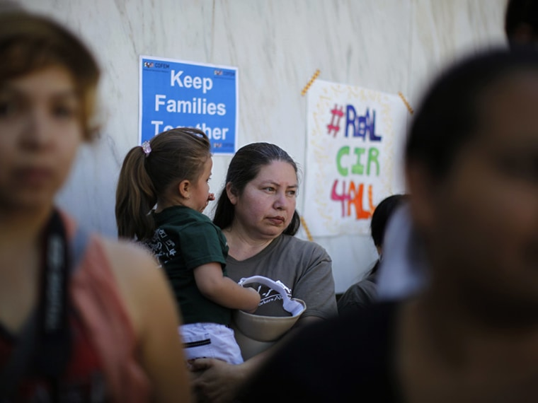 People listen to a broadcast of the debate in Congress at a 24-hour vigil calling on Congress to pass immigration reform in Los Angeles, June 27, 2013.  (Photo by Lucy Nicholson/Reuters)