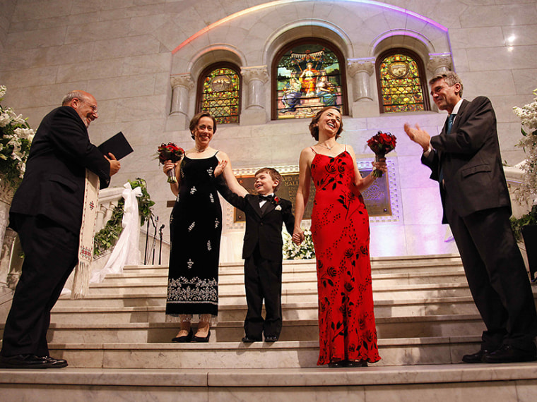 Cathy ten Broeke and Margaret Miles hold their son Louie's hand after walking the steps at Minneapolis City Hall to be married by Reverend James Gertmenian, left, and Mayor R.T. Rybak at the Minneapolis Freedom to Marry Celebration and Weddings,...
