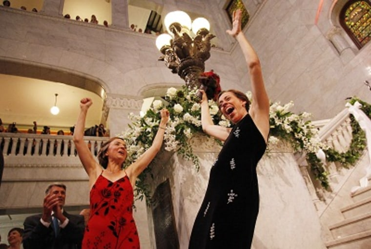 Margaret Miles celebrates with wife Cathy ten Broeke after they were married at the Minneapolis Freedom to Marry Celebration, Thursday, Aug. 1, 2013 at the Minneapolis City Hall. (Photo by Stacy Bengs/AP)