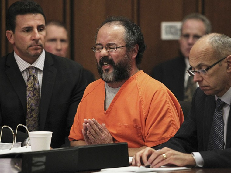 Ariel Castro (C), 53, breaks down while talking about the child that he fathered with Amada Berry as he addresses the court while seated between attorneys Craig Weintraub (L) and Jaye Schlachet in the courtroom in Cleveland, Ohio August 1, 2013.  ...