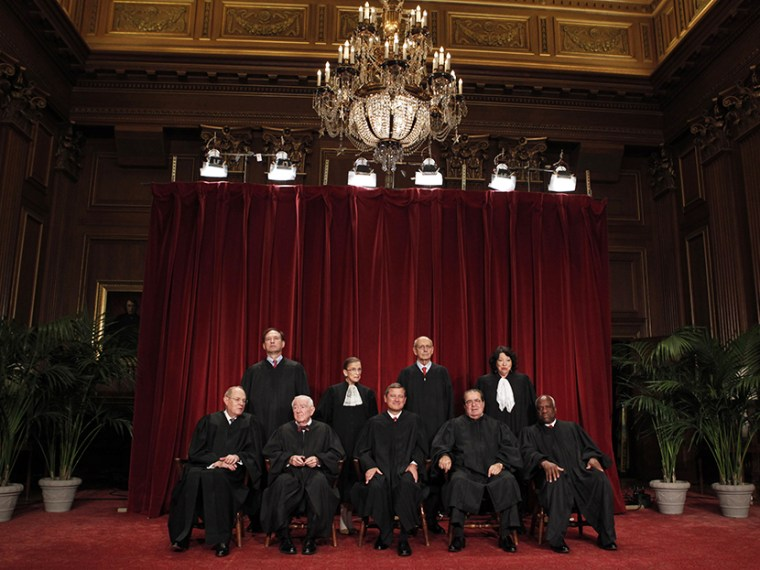 U.S. Supreme Court Justices gather for an official picture at the Supreme Court in Washington, September 29, 2009. (Photo by Jim Young/Reuters)