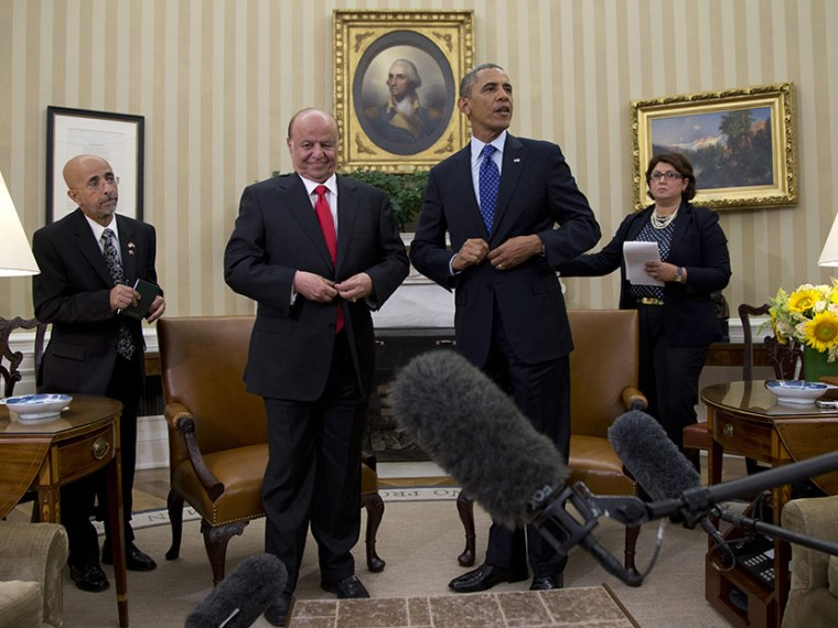 President Barack Obama and Yemen's president, Abdo Rabby Mansour Hadi stand and button their jackets after speaking to the media in the Oval Office of the White House, Thursday, Aug. 1, 2013, in Washington. (Photo by Carolyn Kaster/AP)