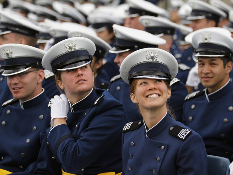Graduating 2nd Lieutenant Natalie Justice, right, smiles during the commencement ceremony for the class of 2013, at the U.S. Air Force Academy in Colorado, Wednesday May 29, 2013. (Photo by Brennan Linsley/AP)