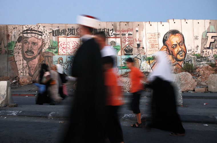 Palestinian Muslim worshipers walk towards the Qalandia checkpoint between Ramallah and Jerusalem, in the occupied West Bank, on the last Friday of the holy month of Ramadan on August 2, 2013, as they head to the al-Aqsa mosque compound in Jerusalem's...