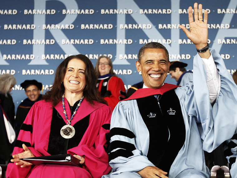 President Barack Obama, accompanied by Barnard College President Debora L. Spar, acknowledges applause as they take their seat before the president gave a commence address at Barnard College, Monday, May 14, 2012, in New York. (Photo by Pablo Martinez...