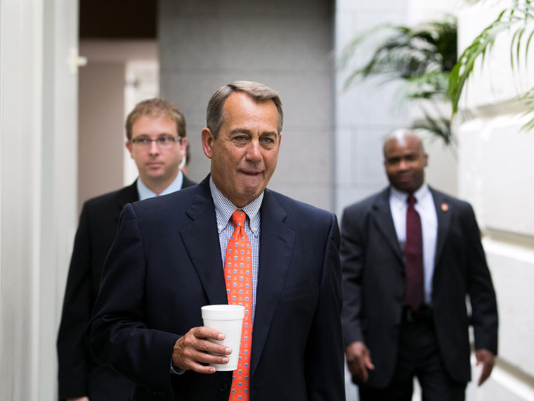 U.S. Speaker of the House John Boehner (R-OH) makes his way to a House GOP caucus meeting, on Capitol Hill, July 9, 2013 in Washington, DC.  (Photo by Drew Angerer/Getty Images)