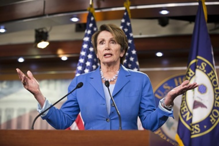 House Minority Leader Nancy Pelosi gestures during a news conference on Capitol Hill in Washington, Friday, Aug. 2, 2013. (Photo by J. Scott Applewhite/AP)
