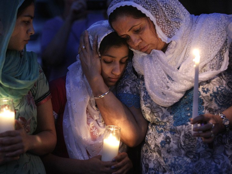 Worshipers in the Sikh community gather for a candle light vigil after prayer services at the Sikh Religious Society of Wisconsin, Monday, Aug. 6, 2012, in Brookfield, Wis. (Photo by M. Spencer Green/AP)