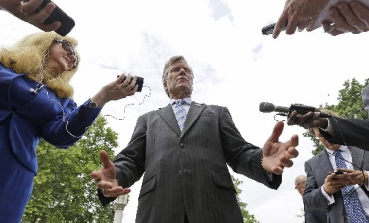 File photo: McDonnell gestures as he answers reporters questions in  Richmond, Va., Monday, June 24, 2013. (Photo by: Steve Helber/AP Photo)