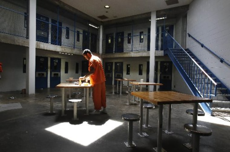 File photo: An inmate uses the recreation room of one of the housing units at  Sacramento County's Rio Cosumnes Correctional Center in Elk Grove, Calif., Thursday, May 30, 2013. (Photo by: Rich Pedroncelli/AP Photo)