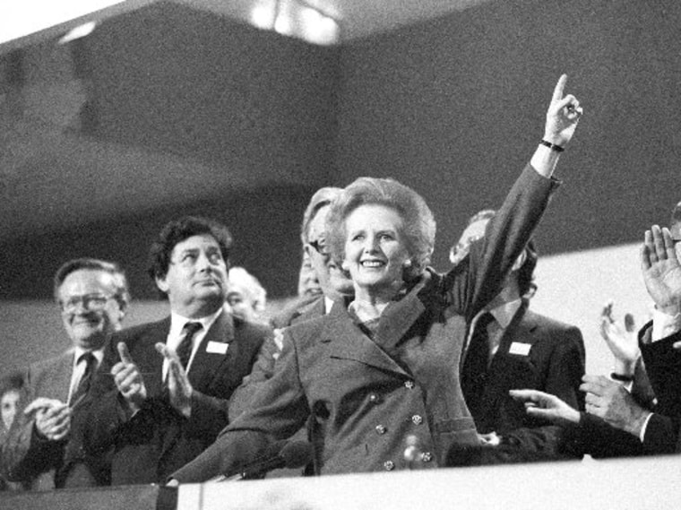 Then British Prime Minister Margaret Thatcher points skyward as she receives standing ovation at Conservative Party Conference in this October 13, 1989 file photo. Thatcher has died following a stroke, a spokesman for the family said. REUTERS/Stringer...