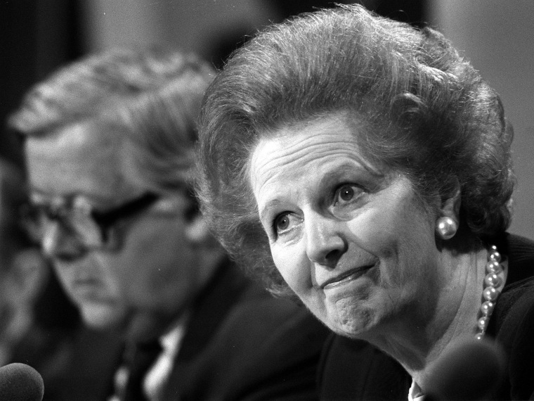 File photo dated 22/5/89 of Margaret Thatcher fielding questions with Foreign Secretary, Geoffrey Howe (background), at a press conference, in London. (Photo by Martin Keene/Press Association via AP Images, File)