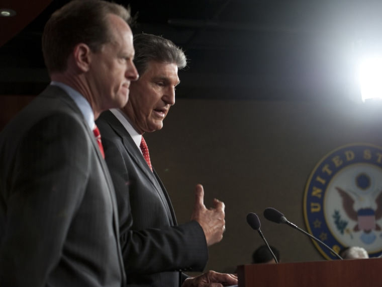 Sen. Pat Toomey, R-Pa., and Sen. Joe Manchin, D-W.V., speak at a press conference about their bi-partisan agreement to propose legislation to strengthen background checks to prevent criminals and those with mental illness from buying guns on April 10,...
