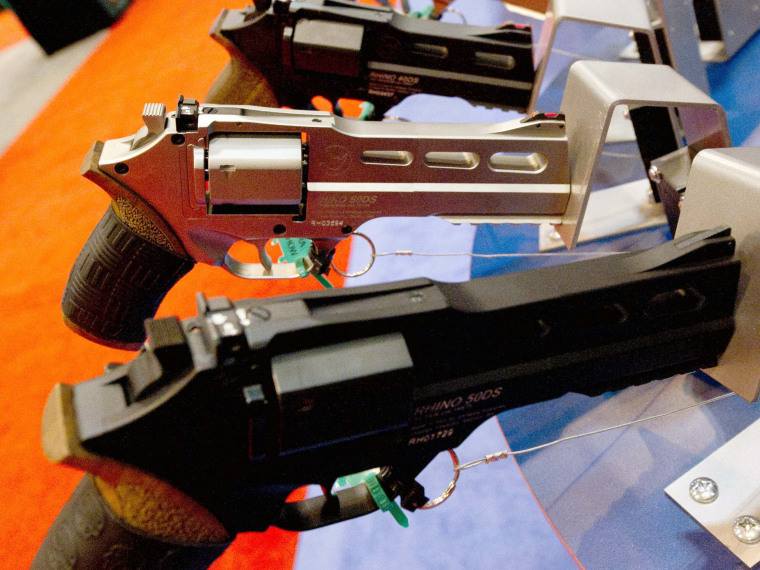 File Photo: Rhino 500 handguns are on display at the National Rifle Association (NRA) Annual Meetings and Exhibits on April 14, 2012 in St. Louis, Missouri.  (Photo by Karen Bleier/AFP/Getty Images, File)