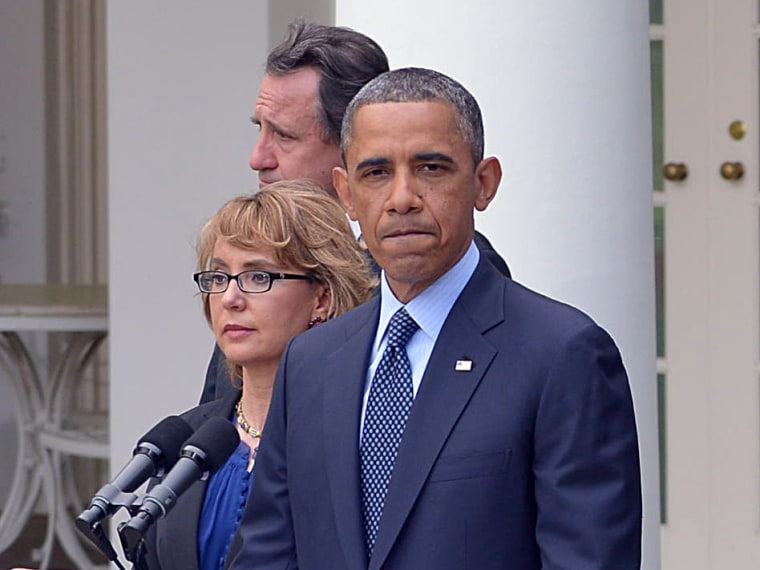 US President Barack Obama, accompanied by former lawmaker Gabrielle Giffords (L),  speaks on gun control and the vote at the US Senate on April 17, 2013, in the Rose Garden of the White House (Photo by Mandel Ngan/AFP/Getty Images)