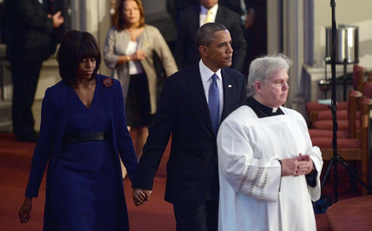 """President Barack Obama and first lady Michelle Obama arrive at the """"Healing Our City: An Interfaith Service"""" dedicated to those who were gravely wounded or killed in the Boston Marathon bombing, at the Cathedral of the Holy Cross in Boston,..."""