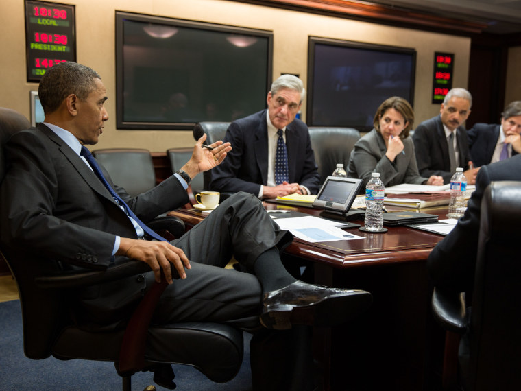 In this handout provided by the White House, U.S. President Barack Obama (L) meets with members of his national security team to discuss developments in the Boston bombings investigation, in the Situation Room of the White House on April 19, 2013 in...