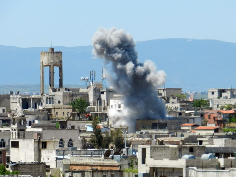 A picture taken on April 26, 2013 shows smoke rising after shelling in Houla in Syria's Homs province. The opposition National Coalition has accused the regime of using chemical weapons in the northern province of Aleppo, in Homs in central Syria, and...