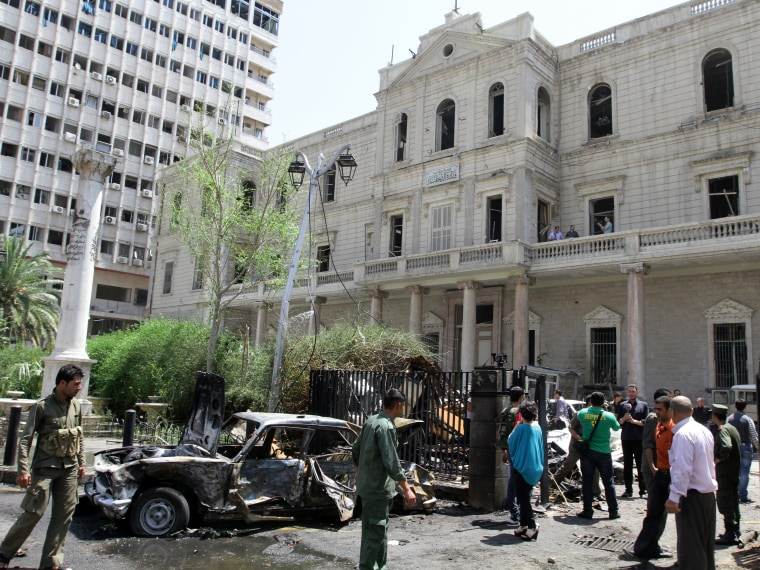 A destroyed car sits outside the Syrian Interior Ministry following a bomb blast in the Marjeh district of Damascus on April 30 , 2013. A blast in the central Damascus district of Marjeh killed at least 14 people, Syrian state television reported, a...
